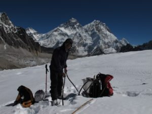 Installation of an ablation stake on Changri Nup Glacier, October 2010. Everest is visible in the background (© P. Wagnon).